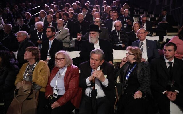 Attendees, including Holocaust survivors, at the Fifth World Holocaust Forum at the Yad Vashem Holocaust memorial museum in Jerusalem on January 23, 2020. Their faces lined by age and haunting memories, about 100 Holocaust survivors joined political leaders in Jerusalem to recall the liberation of the Auschwitz death camp 75 years earlier. (Abir Sultan/Pool/AFP)