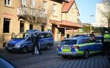 Police cars are seen at the site where a shooter, believed to have a personal motive, launched an assault on January 24, 2020 in the town of Rot am See in southwestern Germany. - (Photo by Sebastian Gollnow / DPA / AFP)