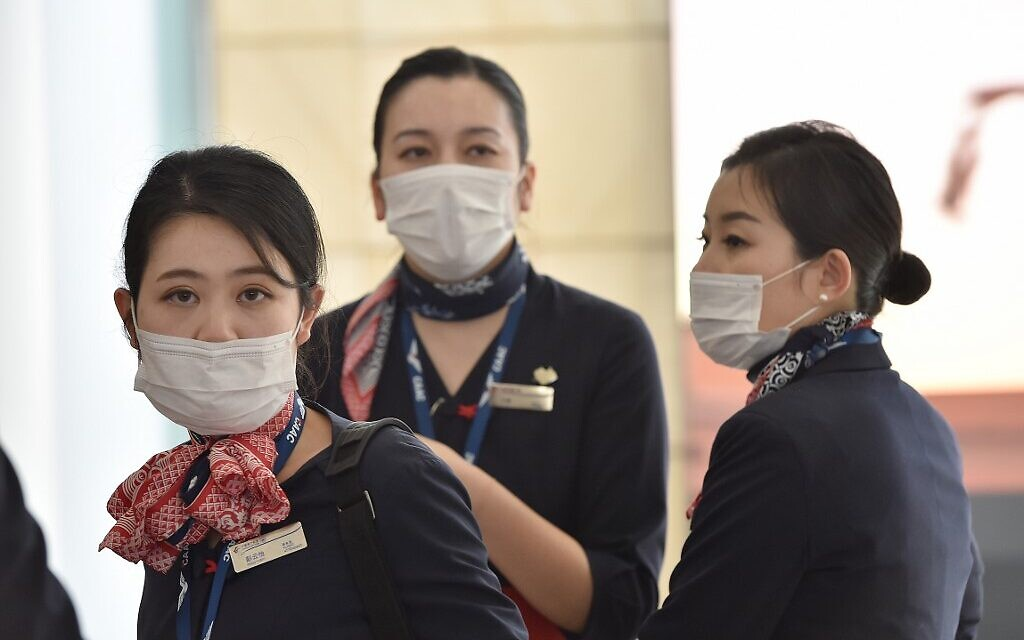 China Eastern Airlines aircrew arrive at Sydney airport after landing on a plane from Shanghai on January 25, 2020. (Peter Parks/AFP)