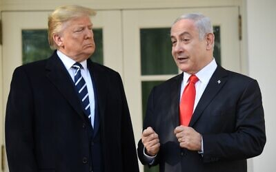 US President Donald Trump greets Prime Minister Benjamin Netanyahu as he arrives for a meeting on the South Lawn of the White House in Washington, DC, January 27, 2020. (Saul Loeb/AFP)