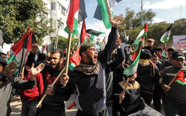 Palestinian demonstrators chant slogans and wave Palestinian flags during a protest against US President Donald Trump's expected peace plan proposal in Gaza City on January 28, 2020. (Mahmud Hams/AFP)