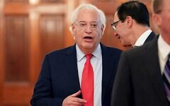 US Ambassador to Israel David Friedman (L) speaks with US Treasury Secretary Steven Mnuchin before US President Donald Trump and Israeli Prime Minister Benjamin Netanyahu announce Trump's Middle East peace plan in the East Room of the White House in Washington, DC on January 28, 2020. (Mandel Ngan/AFP)