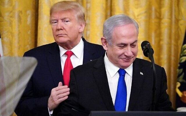 US President Donald Trump, left, and Prime Minister Benjamin Netanyahu take part in an announcement of Trump's Middle East peace plan in the East Room of the White House in Washington, DC on January 28, 2020. (Mandel Ngan/AFP)