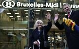 British members of the European Parliament from the Brexit Party Jonathan Bullock (R) and Ann Widdecombe wave in front of the train station as they leave in Brussels on January 31, 2020, Brexit day (Kenzo TRIBOUILLARD / AFP)