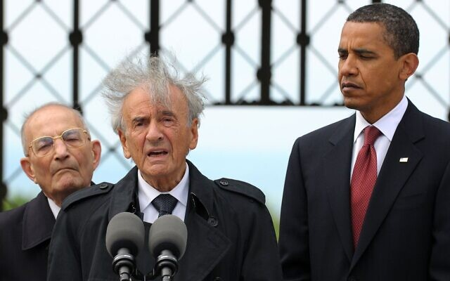 Buchenwald concentration camp survivor Elie Wiesel speaks while then-President Barack Obama and International Buchenwald Committee President Bertrand Herz listen during their visit of the former Buchenwald concentration camp near Weimar, Germany, June 5, 2009 (Pool/Getty Images via JTA)