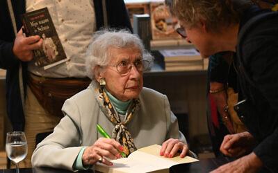 Selma van de Perre signs her book at the National Holocaust Museum in Amsterdam, January 9, 2020. (Cnaan Liphshiz/JTA)