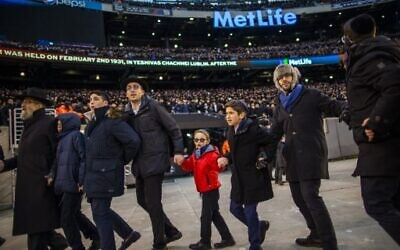 Orthodox Jews sing and dance during the 13th Siyum HaShas, a celebration marking the completion of the Daf Yomi, at the MetLife Stadium on January 1, 2020 in East Rutherford, New Jersey. Security was tightened at the event, where the Talmud is read in its entirety, after a rise in anti-Semitic incidents in the area.  ( Eduardo Munoz Alvarez/Getty Images/AFP)