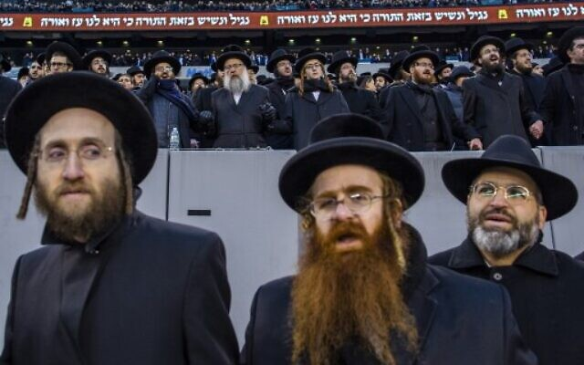 Orthodox Jews attend the 13th Siyum HaShas, a celebration marking the completion of the Daf Yomi, at the MetLife Stadium on January 1, 2020 in East Rutherford, New Jersey. Security was tightened at the event, where the Talmud is read in its entirety, after a rise in anti-Semitic incidents in the area.   (Eduardo Munoz Alvarez/Getty Images/AFP)