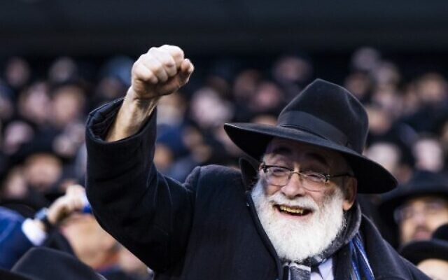 An Orthodox Jew attends the 13th Siyum HaShas, a celebration marking the completion of the Daf Yomi, at the MetLife Stadium on January 1, 2020 in East Rutherford, New Jersey. Security was tightened at the event, where the Talmud is read in its entirety, after a rise in anti-Semitic incidents in the area. (Eduardo Munoz Alvarez/Getty Images/AFP)