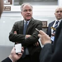 Sen. Tim Kaine (Democrat-Virginia) speaks with reporters in the Senate Subway at the US Capitol in Washington, DC,  January 6, 2020. (Drew Angerer/Getty Images/AFP)