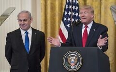 US President Donald Trump andIsraeli Prime Minister Benjamin Netanyahuparticipate in a joint statement in the East Room of the White House, in Washington, DC, on January 28, 2020. (Sarah Silbiger/Getty Images/AFP)
