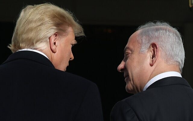 US President Donald Trump (L) welcomes Prime Minister Benjamin Netanyahu at the White House on January 27, 2020 in Washington, DC (Mark Wilson/Getty Images/AFP)