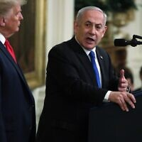 Prime Minister Benjamin Netanyahu (R) speaks during a press conference with US President Donald Trump in the East Room of the White House on January 28, 2020, in Washington. (Alex Wong/Getty Images/AFP)
