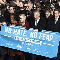 From right: Rep. Jerrold Nadler, Gov. Andrew Cuomo, Sen. Chuck Schumer, Mayor Bill de Blasio and Sen. Kirsten Gillibrand hold a banner at the march against anti-Semitism in New York City, January 5, 2020. (John Lamparski/Echoes Wire/Barcroft Media via Getty Images)
