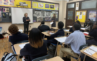Amy Goldberg, left, and Lindsay Bressman talking to students at Bishop Loughlin Memorial High School in Brooklyn, January 8, 2020. (Josefin Dolsten/ JTA)