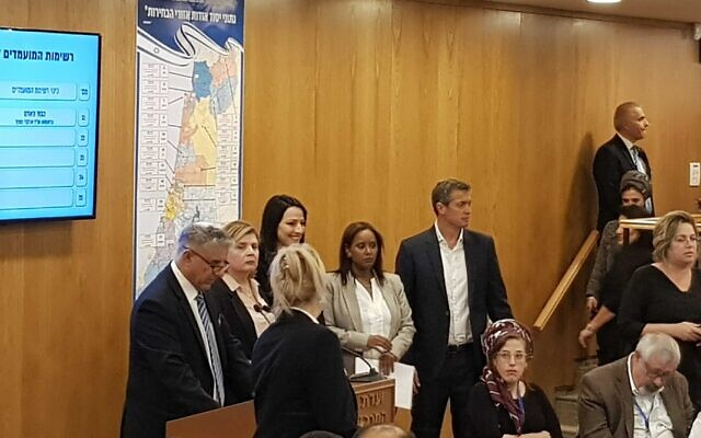 Blue and White MKs register their party's slate for the 23rd Knesset at the Central Elections Committee in Jerusalem on January 15, 2020. (Raoul Wootliff/The Times of Israel)