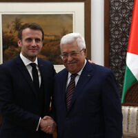 French President Emmanuel Macron (L) and Palestinian Authority President Mahmoud Abbas meeting at the PA presidential headquarters in Ramallah on January 22, 2020. (Wafa)