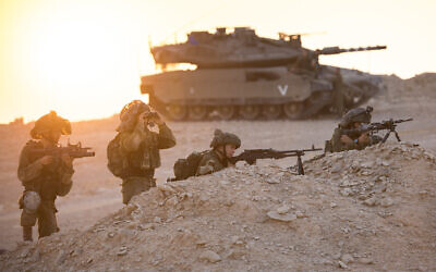 Illustrative. Infantry soldiers take aim in front of a tank during an exercise in southern Israel on August 14, 2017. (Cpl. Eden Briand/Israel Defense Forces/Flickr)