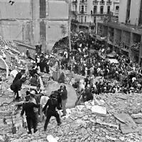 Firemen and policemen search for wounded people after a bomb exploded at the Argentinian Israelite Mutual Association (AMIA in Spanish) in Buenos Aires, 18 July 1994. (ALI BURAFI/AFP/Getty Images via JTA)