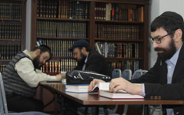 Members of the reestablished Donetsk Jewish community study Talmud in their new synagogue in Kyiv, Ukraine, January 14, 2020. (Sam Sokol/Times of Israel)