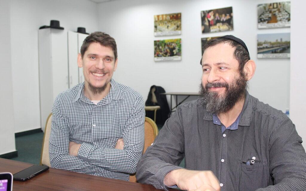 Zushi Plietnov (L), from Luhansk, Ukraine, and Yasha Virin (R), from Donetsk, sit in Kyiv's Donetsk synagogue, January 14, 2020. (Sam Sokol/Times of Israel)