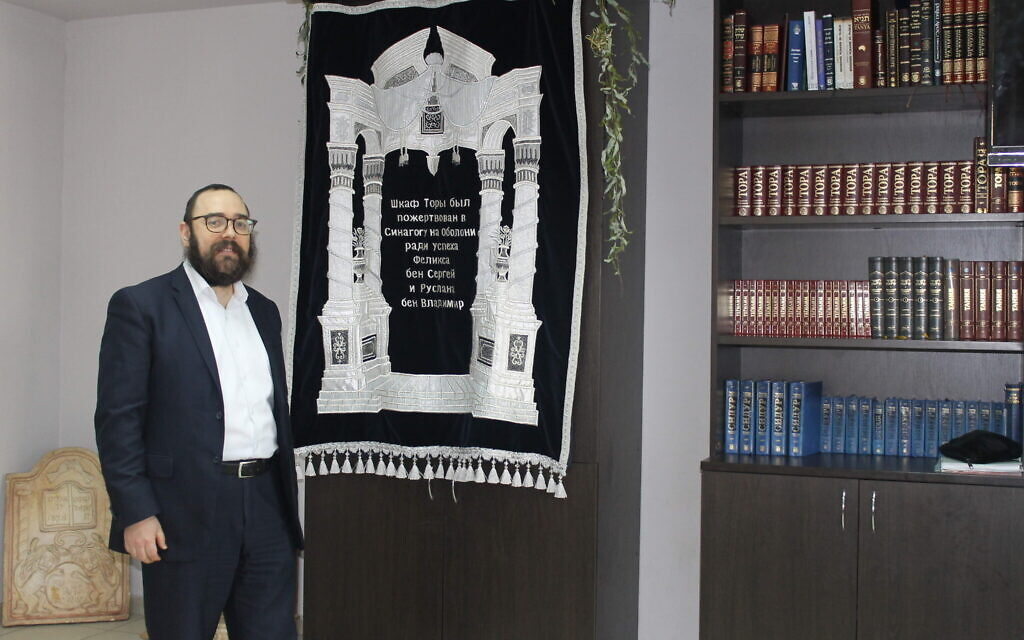 Rabbi Shalom Gopin of Luhansk, Ukraine, stands in his new synagogue in the Kyiv neighborhood of Obolonskyi, January 14, 2020. (Sam Sokol/Times of Israel)