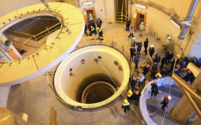 Technicians work at the Arak heavy water reactor's secondary circuit, as officials and media visit the nuclear site, near Arak, 150 miles (250 kilometers) southwest of the capital Tehran, Iran, December 23, 2019. (Atomic Energy Organization of Iran via AP)