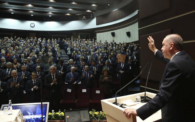 Turkey's President Recep Tayyip Erdogan gestures as he addresses the members of his ruling party, in Ankara, Turkey, December 26, 2019. (Turkish Presidency via AP, Pool)