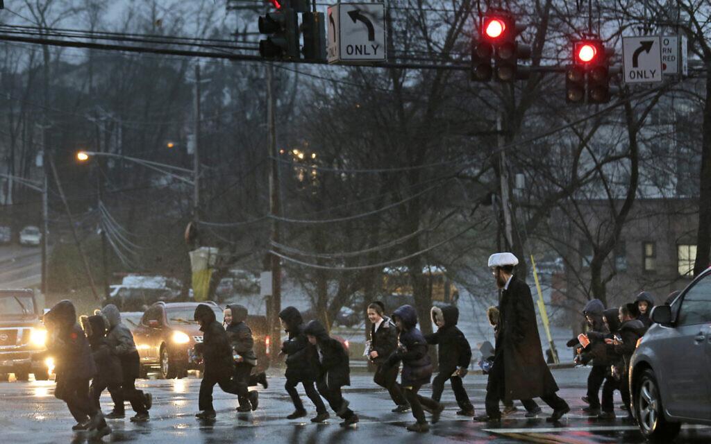 A group of ultra-Orthodox Jewish children cross the street in Monsey, New York, December 30, 2019. (Seth Wenig/AP)