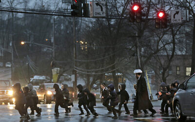 A group of ultra-Orthodox Jewish children cross the street in Monsey, New York, December 30, 2019. (Seth Wenig/AP)