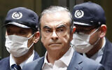 In this April 25, 2019, file photo, former Nissan Chairman Carlos Ghosn leaves Tokyo's Detention Center for bail in Tokyo, Japan. (Kyodo News via AP, File)