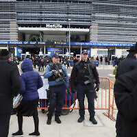 New Jersey State Police officers stand guard in front of MetLife Stadium Wednesday, Jan. 1, 2020, in East Rutherford, N.J., at an event called Siyum HaShas (AP Photo/Ted Shaffrey)