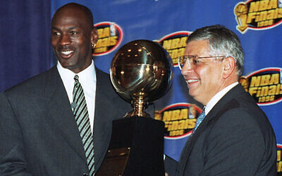 In this June 18, 1996, file photo, Chicago Bulls' Michael Jordan, left, receives the NBA Finals Most Valuable Player trophy from Commissioner David Stern during a ceremony in Chicago. David Stern, who spent 30 years as the NBA's longest-serving commissioner and oversaw its growth into a global power, (AP Photo/Charles Bennett, File)