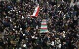Mourners carry the coffins of Iran's Gen. Qassem Soleimani and Abu Mahdi al-Muhandis, deputy commander of Iran-backed militias at the Imam Ali shrine in Najaf, Iraq, January 4, 2020. (Anmar Khalil/AP)