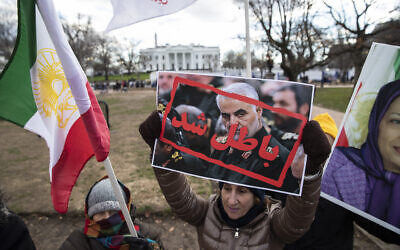 Supporters of the Mujahedeen-e-Khalq, or the MEK, an Iranian exile group, hold signs and flags during a show of support for a US airstrike in Iraq that killed Iranian Gen. Qassem Soleimani, in Lafayette Park across from the White House, Sunday, Jan. 5, 2020, in Washington. (AP Photo/Alex Brandon)