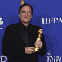 "Quentin Tarantino, winner of the award for best director, motion picture, for ""Once Upon a Time...in Hollywood,"" poses in the press room at the 77th annual Golden Globe Awards at the Beverly Hilton Hotel on January 5, 2020, in Beverly Hills, California. (AP Photo/Chris Pizzello)"
