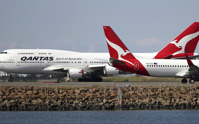 Illustrative: Two Qantas planes taxi on the runway at Sydney Airport in Sydney, Australia, August 20, 2015. (Rick Rycroft/AP)