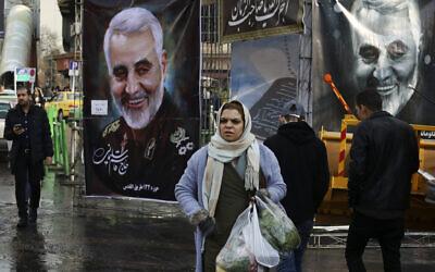 Pedestrians walk past banners of Iranian Revolutionary Guard Gen. Qassem Soleimani, who was killed in Iraq in a US drone attack on Friday, in Tajrish square in northern Tehran, Iran, Thursday, Jan. 9, 2020 (AP Photo/Vahid Salemi)