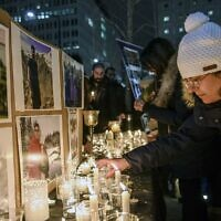 Members of Montreal's Iranian community attend a vigil, Thursday, Jan. 9, 2019 in downtown Montreal (Andrej Ivanov/The Canadian Press via AP)