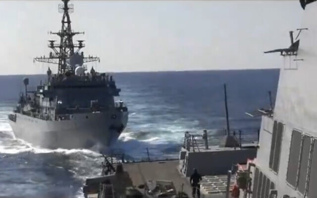This photo provided by the US 5th Fleet, shows a Russian Navy ship approaching an American warship in the North Arabian Sea, on January 9, 2020. (US 5th Fleet via AP)