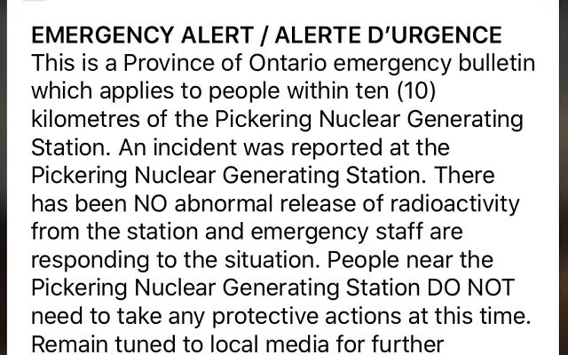 """An emergency alert issued by the Canadian province of Ontario reporting an unspecified """"incident"""" at a nuclear plant is shown on a smartphone Sunday, Jan. 12, 2020. Ontario Power Generation later sent a message saying the alert """"was sent in error."""" (Graeme Roy/The Canadian Press via AP)"""