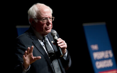 "Democratic presidential candidate Sen. Bernie Sanders, I-Vt., speaks at ""The People's Caucus: Vote Truth to Power"" at the Holzworth Performing Arts Center at Davenport North High School, Sunday, Jan. 12, 2020, in Davenport, Iowa. (AP Photo/Andrew Harnik)"