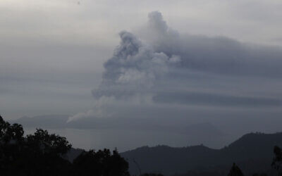 Taal Volcano spews ash on Monday Jan. 13, 2020, in Tagaytay, Cavite province, south of Manila, Philippines.  (AP Photo/Aaron Favila)