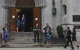 In this September 29, 2019 file photo, members of the Jewish community arrive for services as Pittsburgh Police Detectives provide security on the first night of Rosh Hashana at Calvary Episcopal Church in Pittsburgh. (Rebecca Droke via AP)
