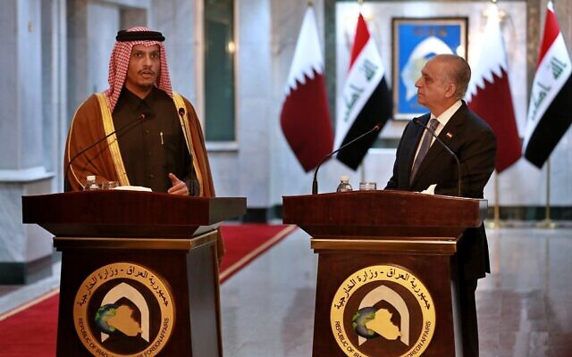 Iraqi Foreign Minister Mohamed Alhahkim, right, holds a press conference with visiting Qatari counterpart Sheikh Mohammed bin Abdulrahman Al Thani in Baghdad, Iraq, January 15, 2020. (Khalid Mohammed/AP)