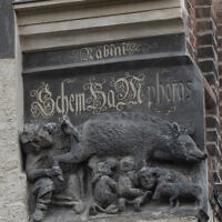 "In this January 14, 2020 photo the so-called Judensau, or ""Jew pig,"" sculpture is displayed on the facade of the Stadtkirche (Town Church) in Wittenberg, Germany. (AP Photo/Jens Meyer)"