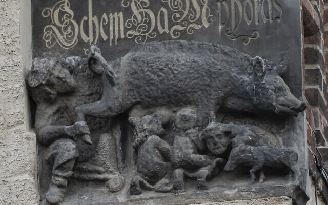 In this Tuesday, Jan. 14, 2020 photo the so-called 'Judensau,' or 'Jew pig,' sculpture is displayed on the facade of the Stadtkirche (Town Church) in Wittenberg, Germany (AP Photo/Jens Meyer)