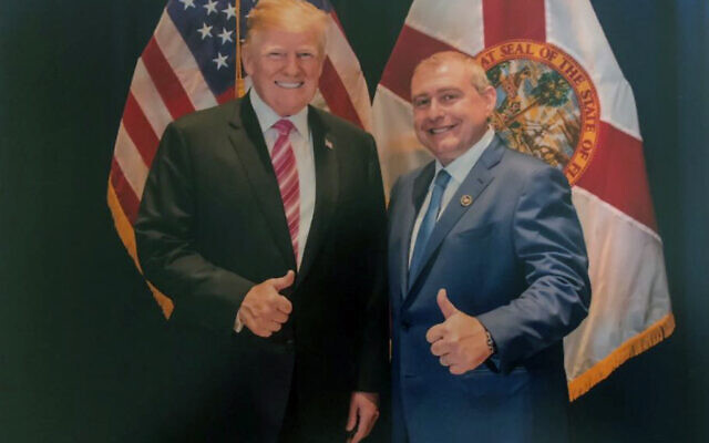 This undated image released by the US House Judiciary Committee from documents provided by Lev Parnas to the committee in the impeachment probe against President Donald Trump, shows a photo of Lev Parnas with Trump in Florida. Parnas, a close associate of Trump's personal lawyer Rudy Giuliani is claiming Trump was directly involved in the effort to pressure Ukraine to investigate Democratic rival Joe Biden. Trump on January 16, 2020, repeated denials that he is acquainted with Parnas, despite numerous photos that have emerged of the two men together. (House Judiciary Committee via AP)
