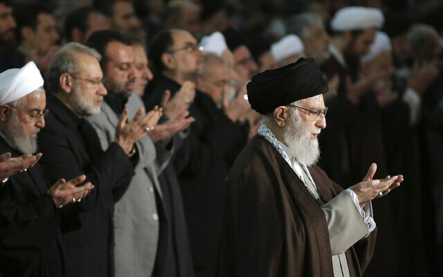 In this photo released by the official website of the office of the Iranian supreme leader, Supreme Leader Ayatollah Ali Khamenei, right, leads the Friday prayers at Imam Khomeini Grand Mosque in Tehran, Iran, Friday, Jan. 17, 2020 (Office of the Iranian Supreme Leader via AP)