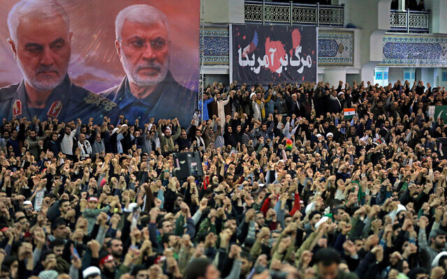 """In this picture released by the official website of the office of the Iranian supreme leader, worshippers chant slogans during Friday prayers ceremony, as a banner show Iranian Revolutionary Guard Gen. Qassem Soleimani, left, and Iraqi Shiite senior militia commander Abu Mahdi al-Muhandis, who were killed in Iraq in a US drone attack on January 3, 2020, and a banner which reads in Persian: """"Death To America, """"at Imam Khomeini Grand Mosque in Tehran, Iran, Friday, January 17, 2020. (Office of the Iranian Supreme Leader via AP)"""